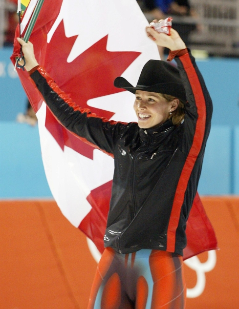 Catriona Le May Doan waves the Canadian flag in celebration