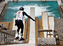 Steve Omischl leaps down on the ramp at the world AcrobatX freestyle aerial competition.