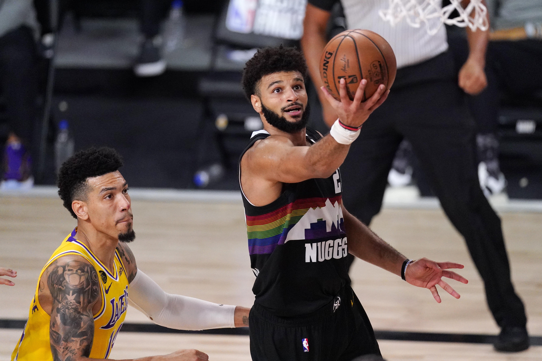 Basketball player attempts a layup
