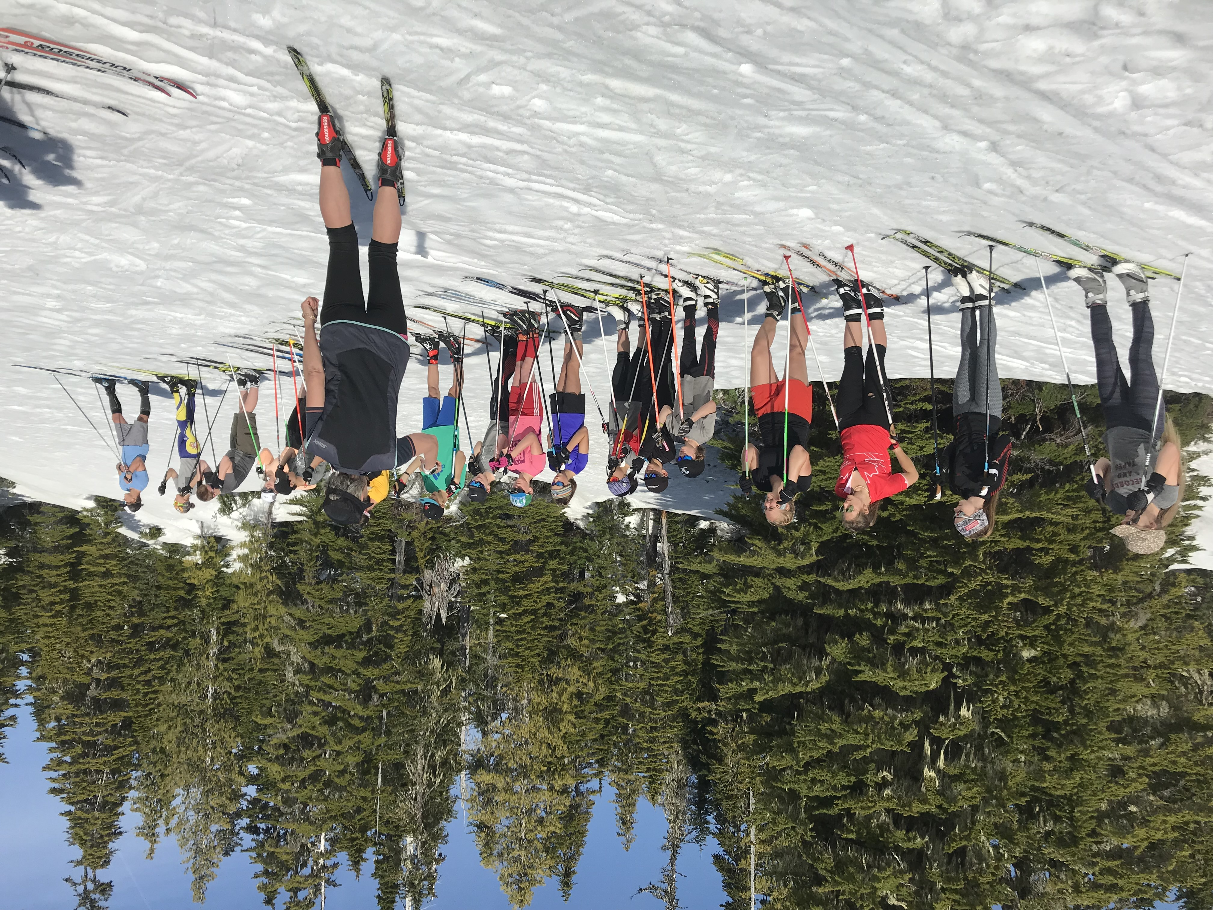 Cross country skiing coach with youth