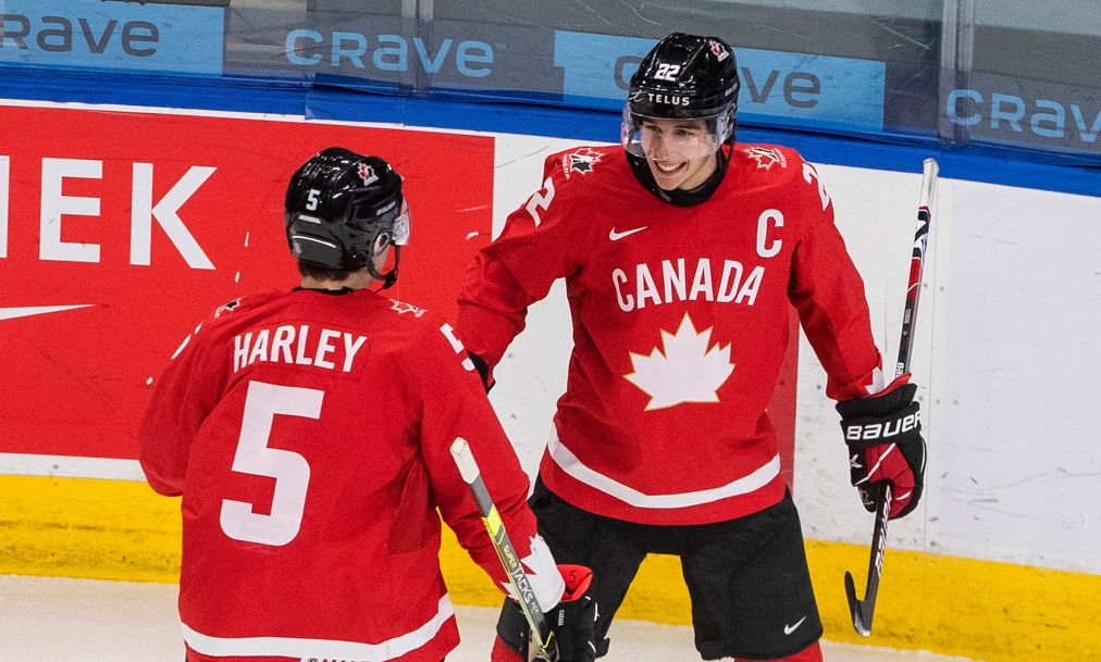 Canada's Thomas Harley (5) and Dylan Cozens (22) celebrate a goal during first period IIHF World Junior Hockey Championship action against Finland, in Edmonton, Thursday, Dec. 31, 2020. THE CANADIAN PRESS/Jason Franson