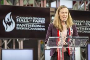 Jayna Hefford speaks at a podium