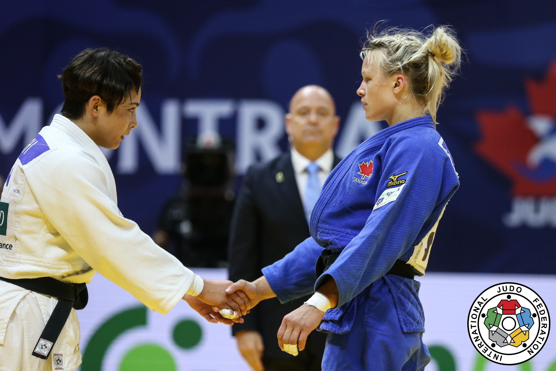 Two judoka shake hands