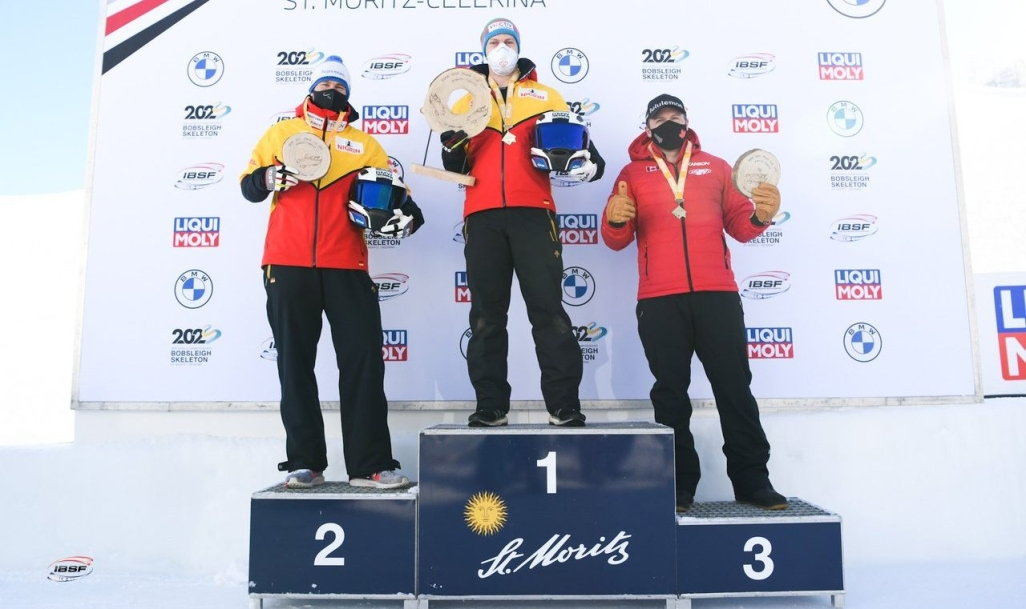 Justin Kripps stands on the podium as Kripps and Cam Stones won their first two-man bobsleigh medal of the World Cup season on Saturday in St. Moritz, Switzerland. (Photo by: IBSF/Viesturs Lacis)