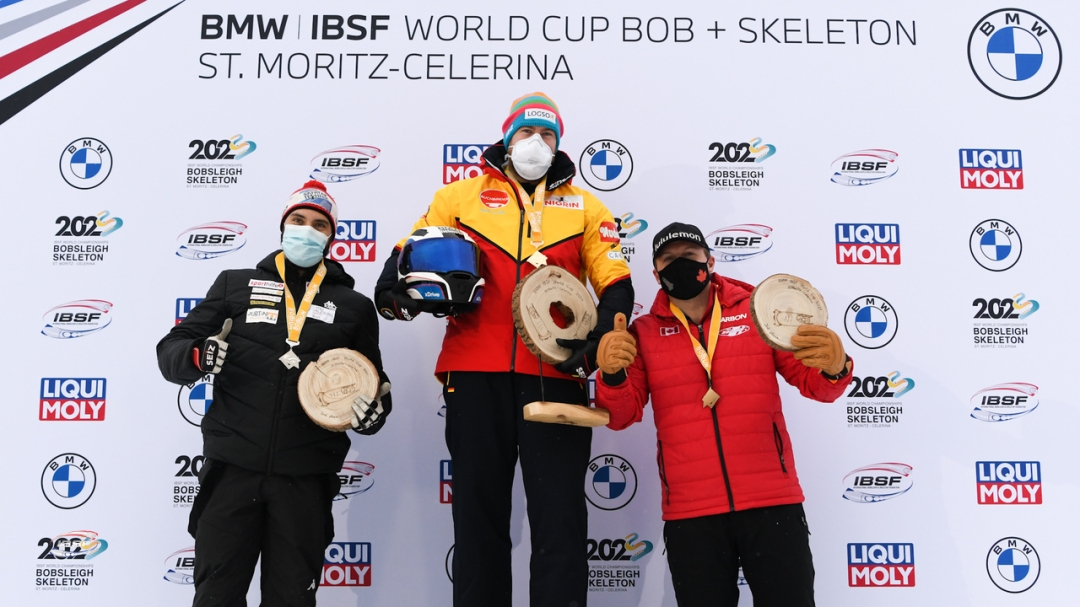 Justin Kripps stands on third step of the podium as the team of Justin Kripps, Ryan Sommer, Ben Coakwell and Cam Stones won a four-man bobsleigh bronze medal at the World Cup on Sunday January 17, 2021 in St. Moritz, Switzerland. (Photo by: IBSF/Viesturs Lacis)