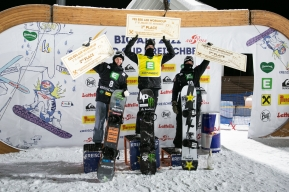 Max Parrot (centre) holds up his cheque after winning the world cup event.