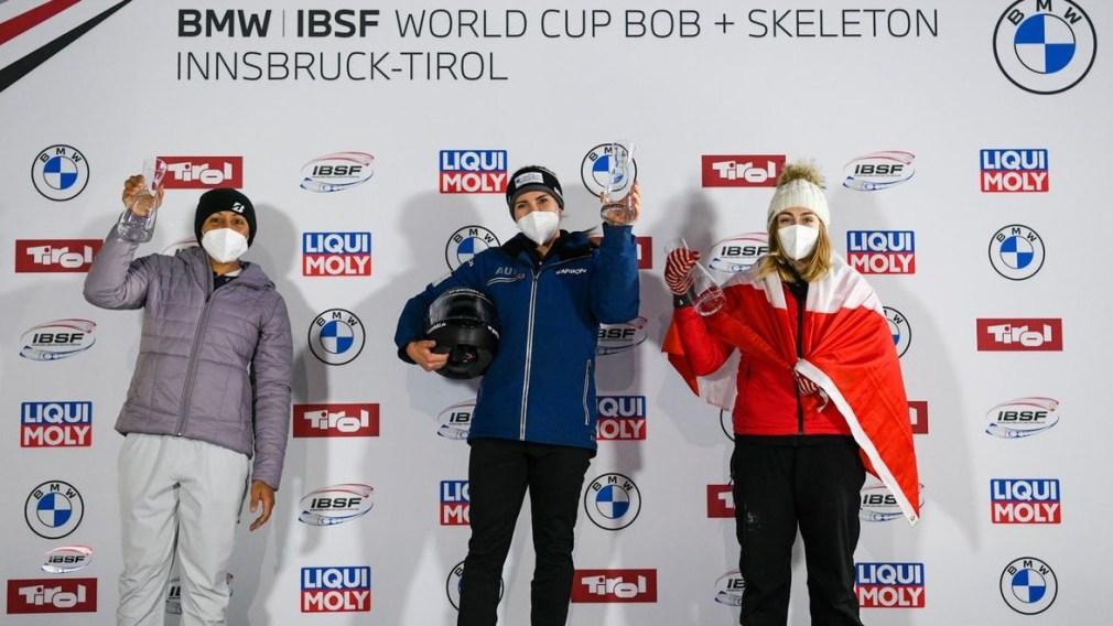 Melissa Lotholz stands on monobob podium