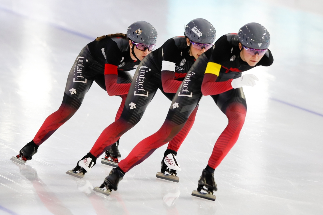Valerie Maltais, center, Ivanie Blondin, left, and Isabelle Weidemann, right, compete during the women's team pursuit race.