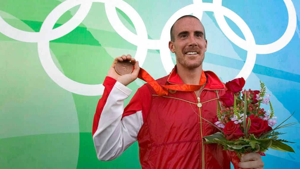 Tom Hall holds his bronze medal from Beijing 2008