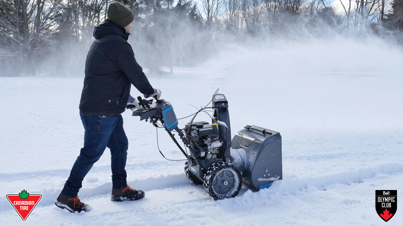 A person pushing a snowblower
