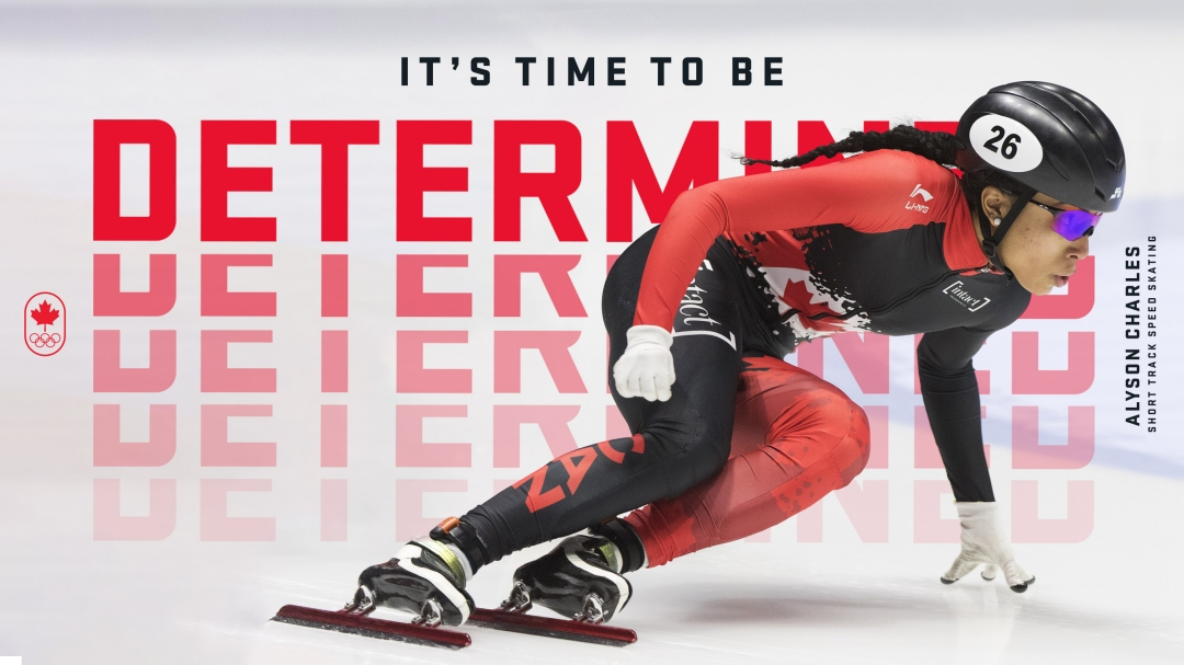 Short track speed skater in a lean on ice