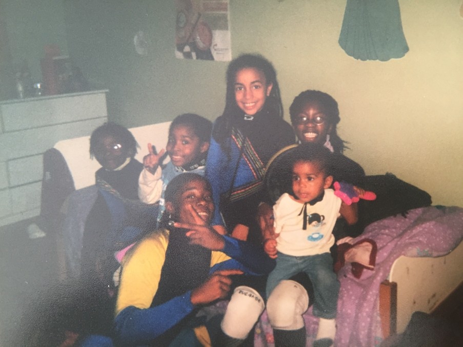 Alyson Charles as a child with her cousins