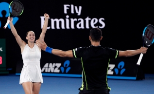 Canada's Gabriela Dabrowski, left, and Croatia's Mate Pavic celebrate