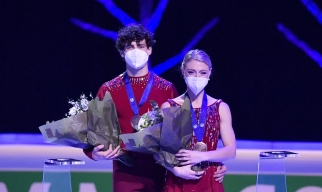 Piper Gilles and Paul Poirier of Canada stand on the podium after winning the bronze during the Ice Dance-Free Dance at the Figure Skating World Championships in Stockholm, Sweden, Saturday, March 27, 2021.