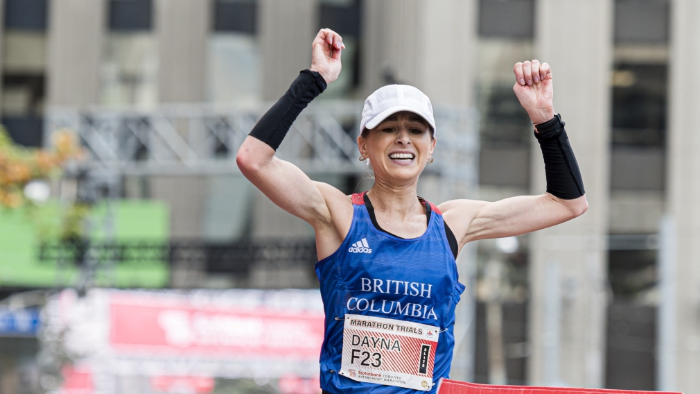 Dayna Pidhoresky raises her arms in triumph
