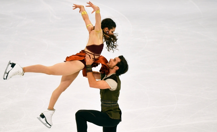 Laurence Fournier Beaudry and Nikolaj Sorensen of Canada perform during the Ice Dance-Free Dance at the Figure Skating World Championships in Stockholm, Sweden, Saturday, March 27, 2021. (AP Photo/Martin Meissner)