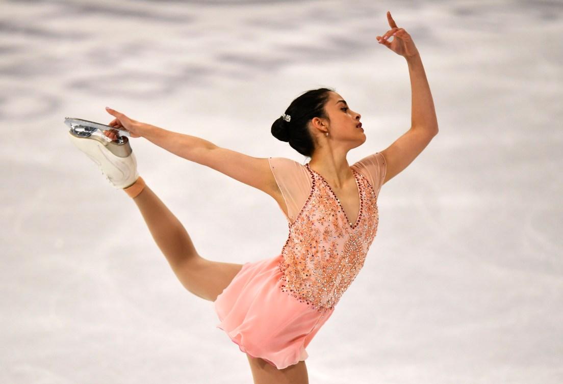 Figure skater performs an arabesque