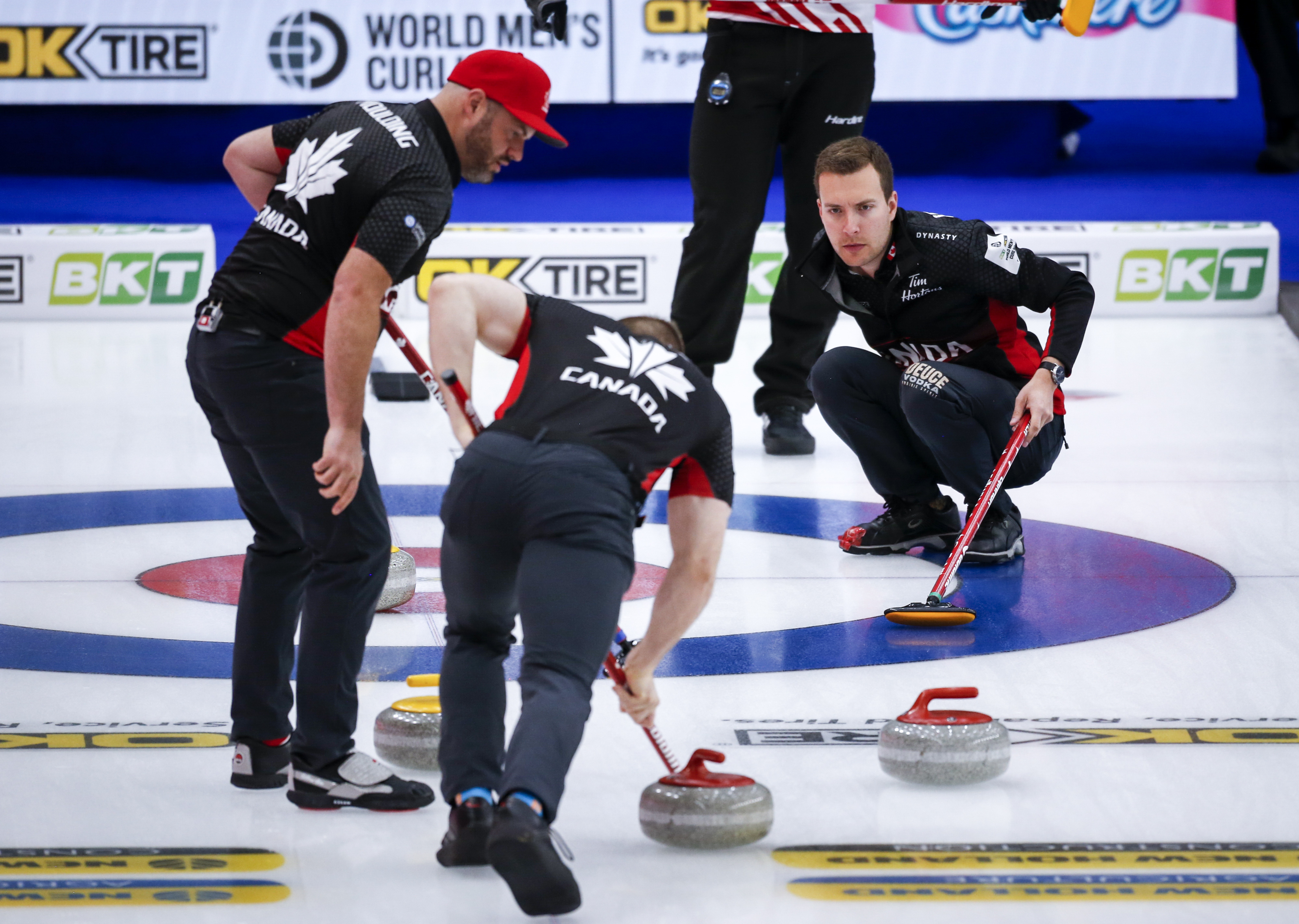 Team Canada skip Brendan Bottcher, centre, directs his teammates as they play Denmark at the Men's World Curling Championships in Calgary, Alta., Saturday, April 3, 2021.