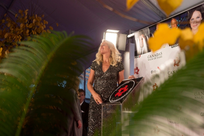 Silken Laumann poses for photographs with her plaque as she is inducted into Canada's Walk of Fame during an event in Toronto on Saturday, November 7, 2015.