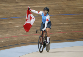 Kelsey Mitchell celebrates with a Canadian flag