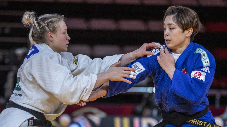 Two female judokas mid match