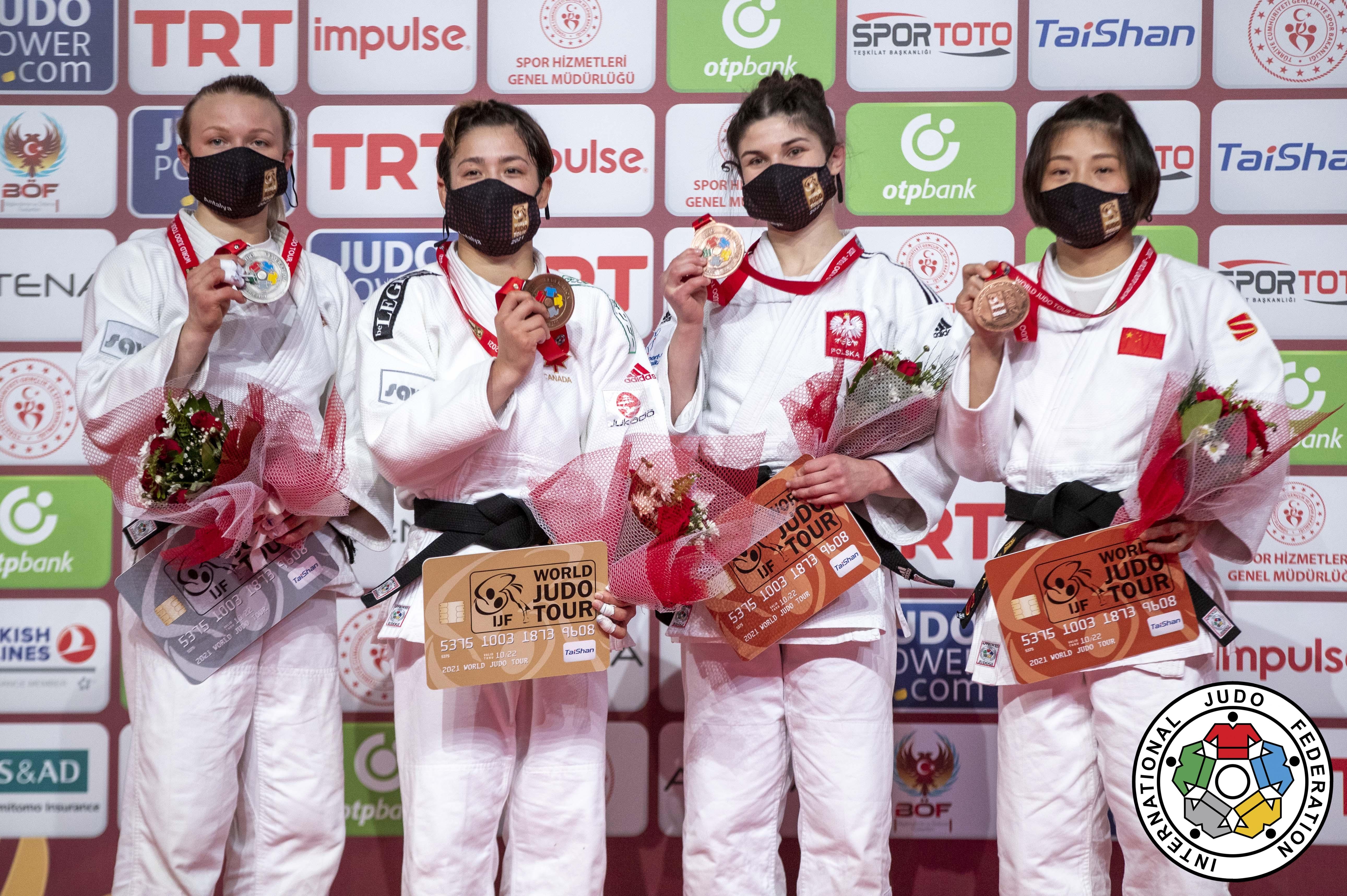 Four female judokas on podium