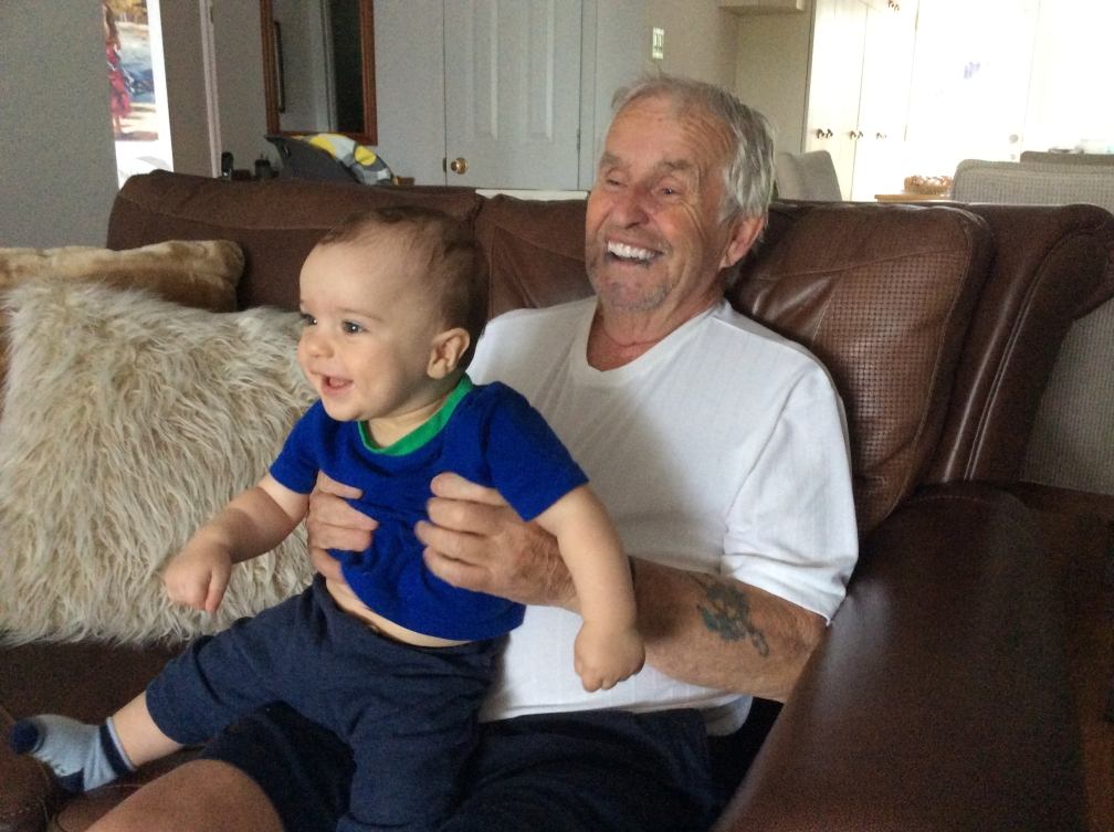 Annie Pelletier's father holds his baby grandson
