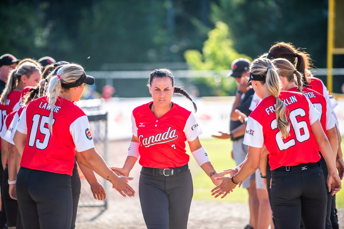 Jennifer Salling clapping hands of teammates