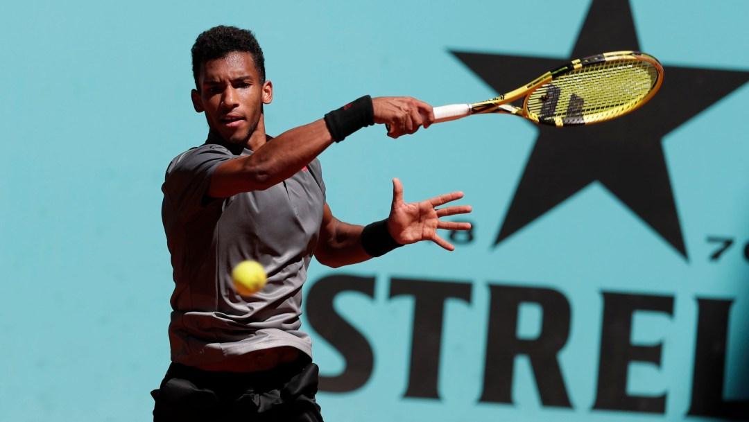 A tennis player hits a ball