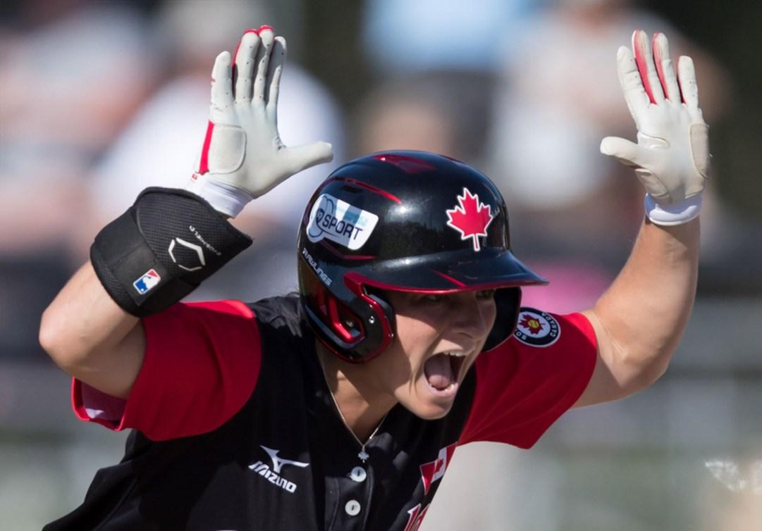 Joey Lye raises both arms in celebration