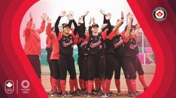 Women's softball team waves to crowd