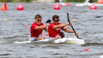 Two male kayakers in their boat