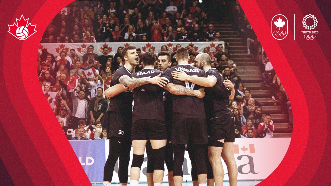 Men's volleyball players in a huddle