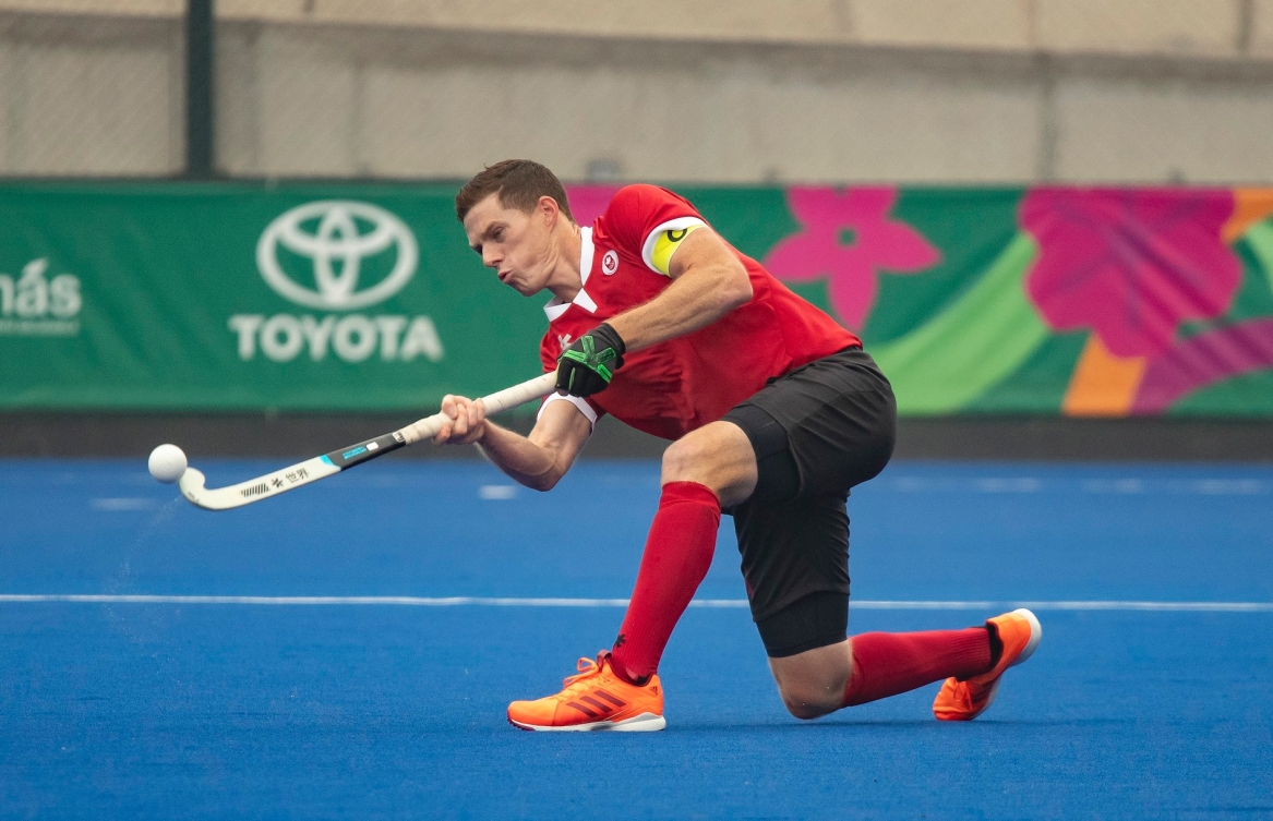 Scott Tupper of Canada plays the ball against the United States in field hockey at the Lima Pan American Games on Aug. 1, 2019. THE CANADIAN PRESS/HO-COC, Andrew Lahodynskyj,