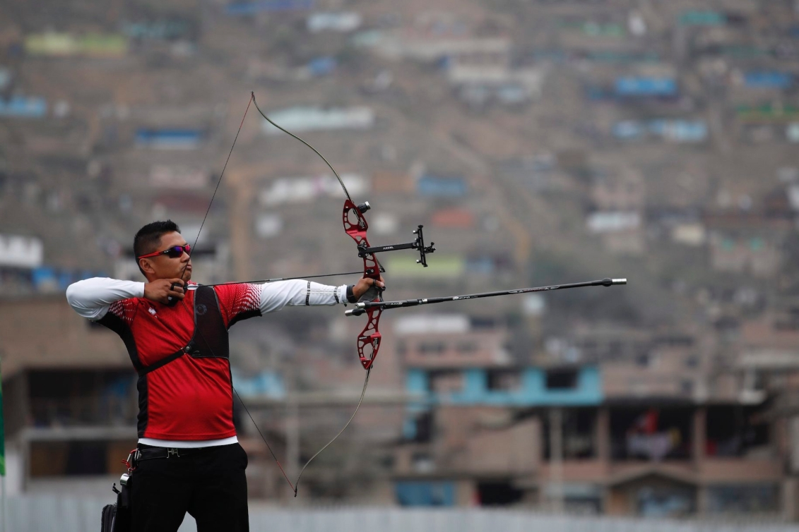 Crispin Duenas of of Canada competes to win the gold medal in the men's archery recurve individual final against Marcus Dalmeida at the Pan American Games in Lima, Peru, Sunday, Aug. 11, 2019. (AP Photo/Moises Castillo)