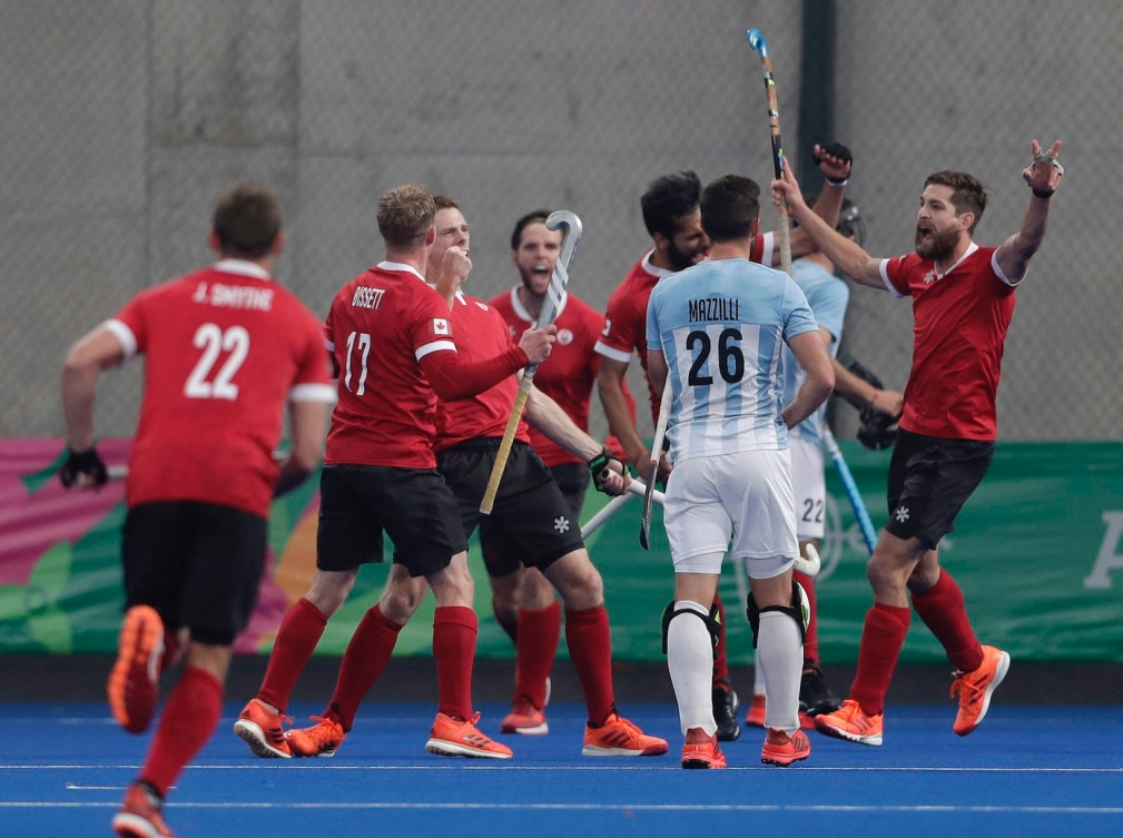 Canada celebrates after they scored their 4th goal against Argentina in the men's field hockey gold medal matchof the Pan American Games in Lima, Peru, Saturday, Aug. 10, 2019. (AP Photo/Silvia Izquierdo)