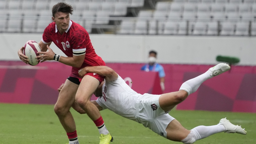Andrew Coe tries to avoid being tackled