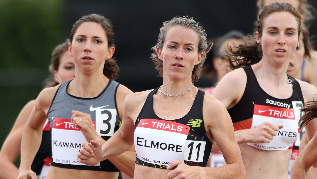 Maldini Elmore running on the track