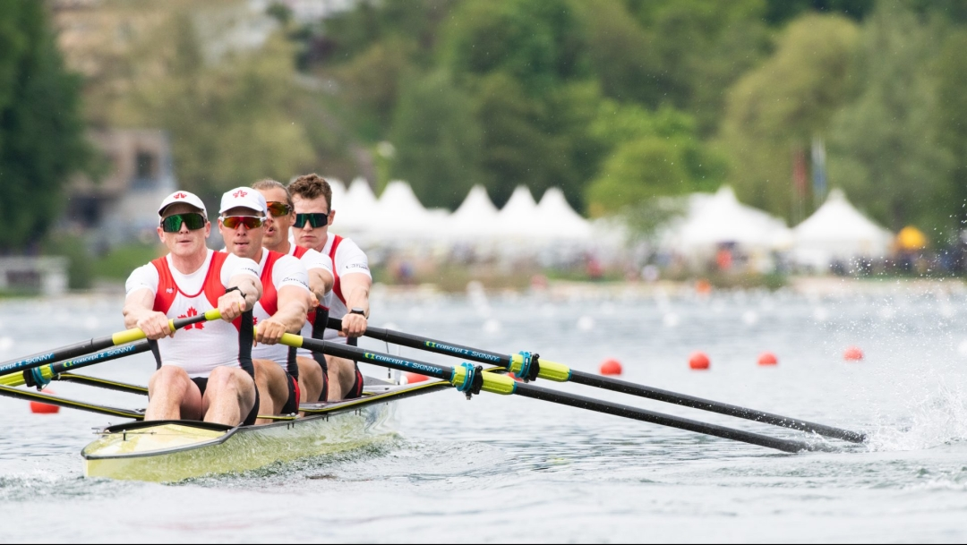 Four male rowers in their boat