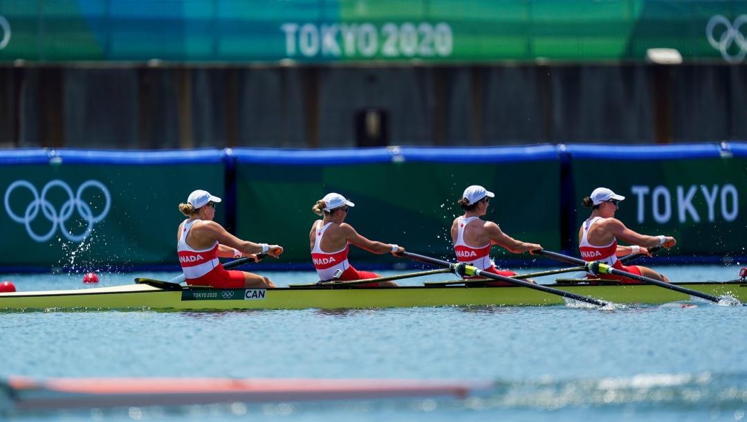 Women's four rowing boat in a race