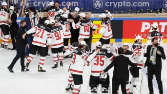 Team Canada celebrates IIHF World Championship gold on June 6 with a 3-2 overtime win over Finland