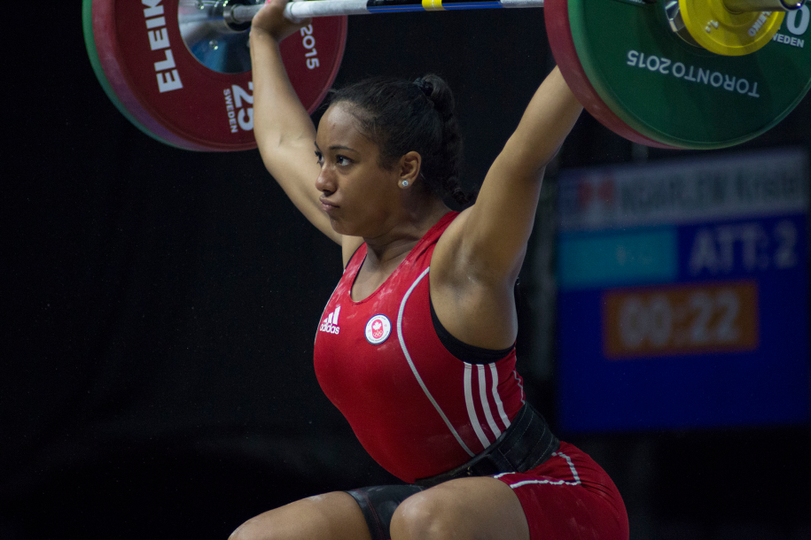 weightlifter holds weight above head