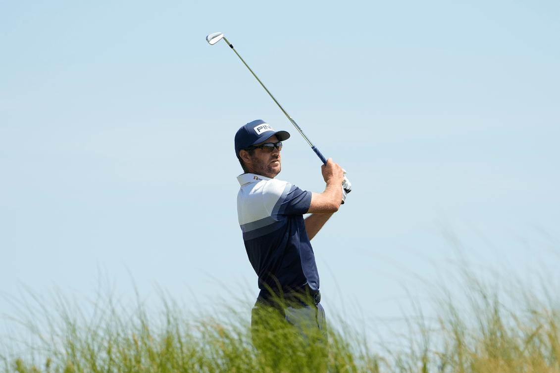 Golfer hits ball