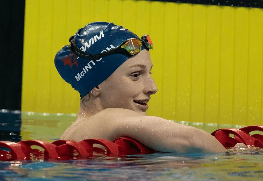swimmer smiles in pool