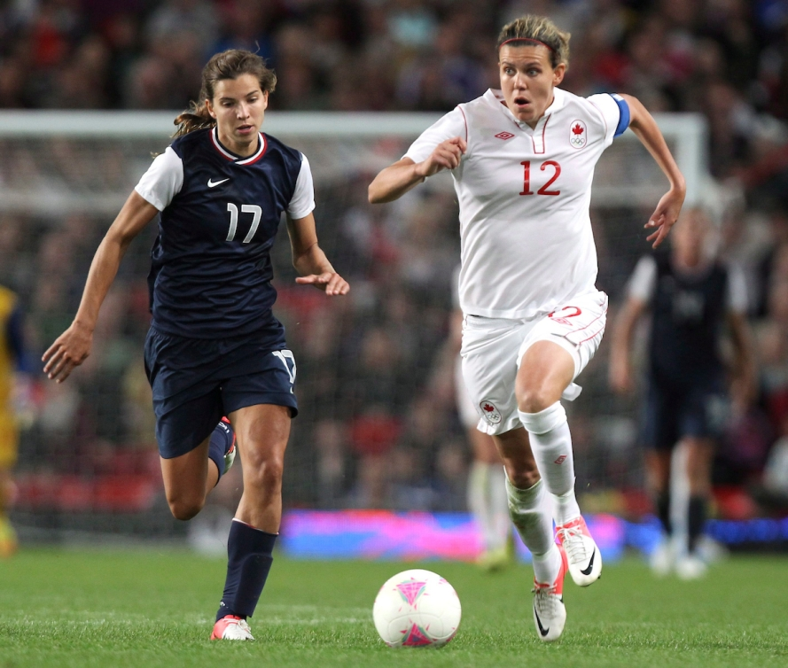 Tobin Heath and Christine Sinclair chasing the ball at London 2012