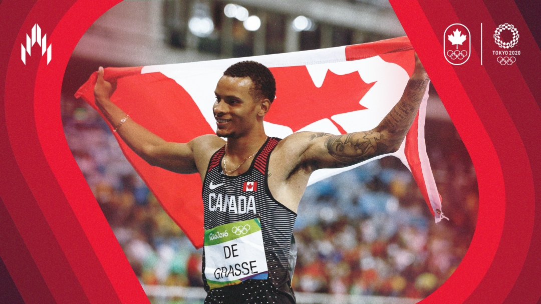 Andre De Grasse holds the Canadian flag