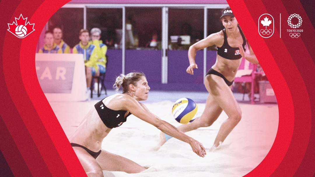 Beach volleyball player makes a dig