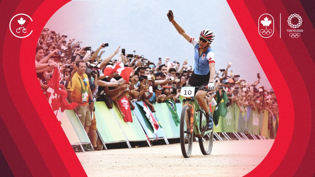 Cyclist raises arm while crossing finish line