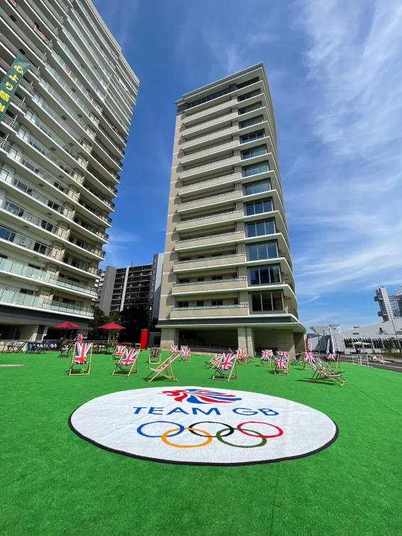 Apartment style multi-floor building with Team Australia and Team Great Britain identifiers on the outside