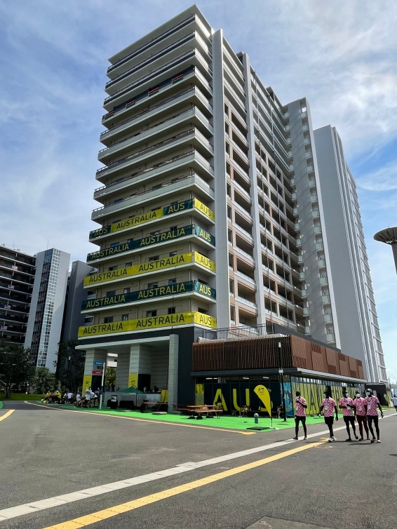 Apartment style multi-floor building with Team Australia identifiers on the outside